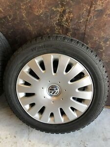 VW WINTER TIRES ON STEEL RIMS WITH HUB CAPS