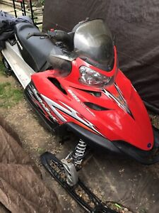 2006 Polaris switchback, 2007 Polaris edge touring