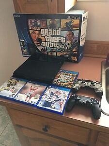 PS4 2 controllers and games.