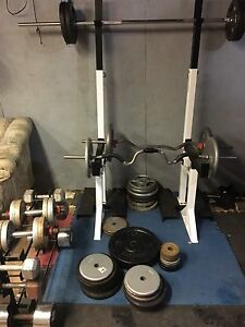Squat rack stands, bars, weight and dumbbell set