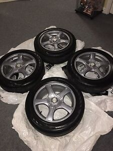 """Set of Four 16"""" Alloy Rims and All Season Tires"""