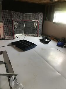 Complete hockey room 400 square feet with net