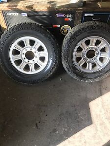 Two ford rims and tires $100 takes them