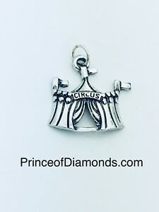 Silver coloured circus pendant charm