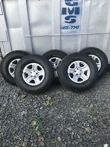 Set of five jeep wheels and tires!!