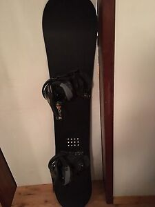 Salomon Drift Rocker Snowboard with Burton Bindings.