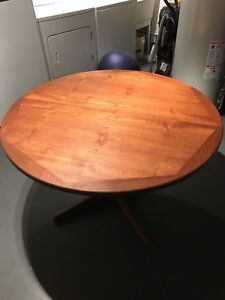 Solid teak dining table - extending seats 4-10