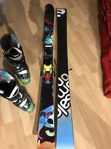 Barely used Solomon twin tips and Nordica Double Six boots!