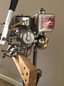 Fully restored 1936 Johnson outboard show piece