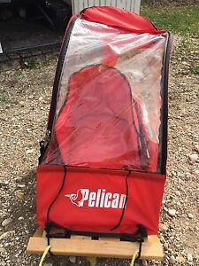 Pelican enclosed infant sled