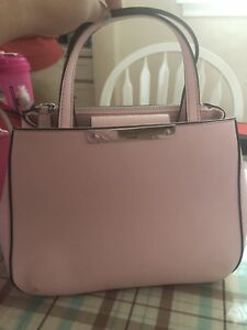 Sell a pink guess purse with matching wallet.