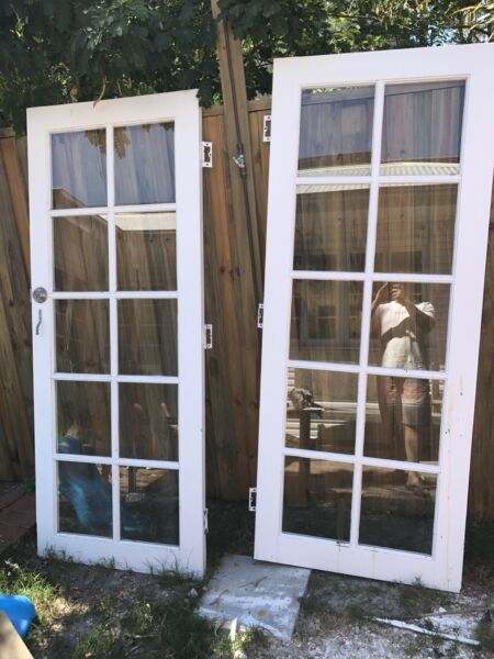 Timber French doors with door jam and hinges and lock | Building ...