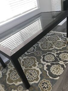 Dark wood kitchen table with glass Center