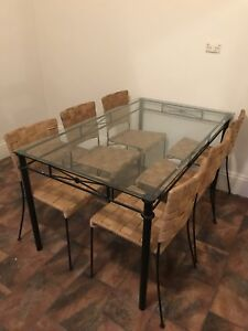 Wrought iron glass table top dining suite with cane/wicker chairs