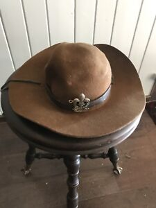 Vintage Boy Scout hat and badges  Leather trim in hat is torn