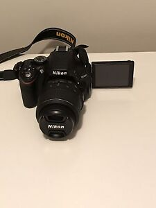 Nikon D5100 Camera with 32GB SD card, lens and case
