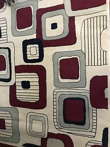 2  5x7 area rugs identical great confition