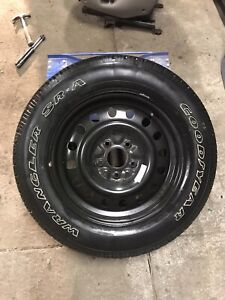 BRAND NEW P235/65R17 Goodyear Wrangler SR-A tire and steel rim