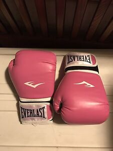 Pink unused boxing gloves