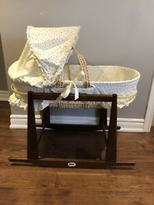 Wicker bassinet basket with wooden Jolly Jumper stand