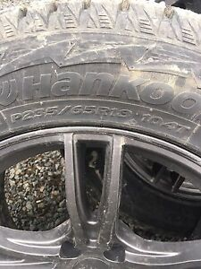 Studded Hankook tires with rims.