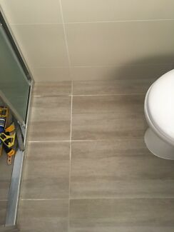 Wanted: Looking for tiler to remove grout and replace with epoxy grout