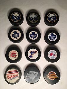 Authentic 1980s NHL game pucks