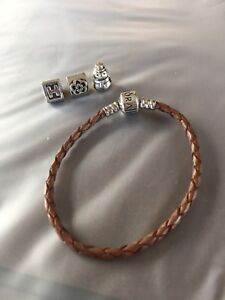 Pandora leather bracelet + charms (will sell separate)