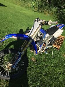 2014 yzf 250 4stroke  $3900 o.b.o or sled trade of equal value