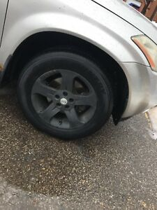 Nissan rims with tires set of 4