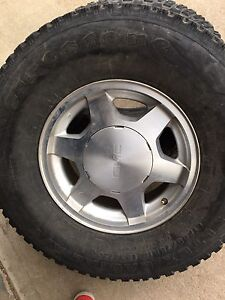 """4 firestone steeltex radial A/T tires and 16"""" gmc rims"""