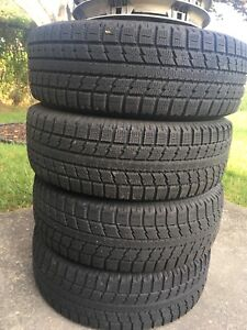 Toyo Snow Tires. New with Rims snd hubcaps