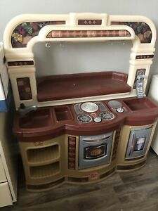 Kids toy kitchen with accessories $100. Like new