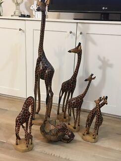 Wooden giraffes and bowl.
