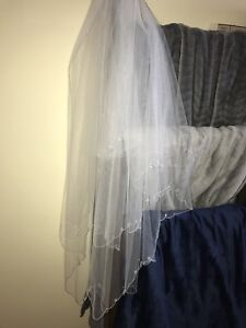 Cascading veil with hanging crystals