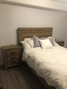 Wooden bed frame with side tables