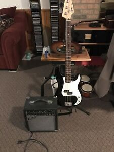 Electric bass guitar Squier by Fender Ampli accessary incl .