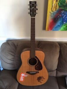 Yamaha Transacoustic series guitar with floral pattern $500.00