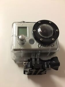 GoPro Hero camera with battery and all cables