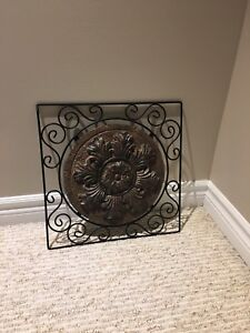 Metal  wall art. Clay centre and metal