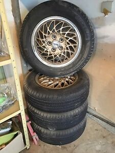 Almost New all season tires on gold ABS rims