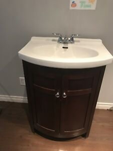 Bathroom vanity with sink and faucet.
