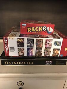 Games plus assorted puzzles all pieces are in tact