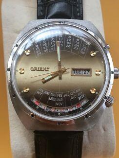 Vintage orient calendar men's watch