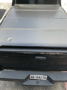 Ranger truck bed covers one is tri fold one is fiberglass