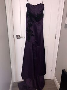 Elegant purple dinner gown with train