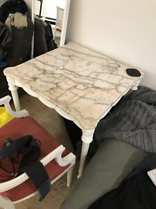 Marble table and two chairs