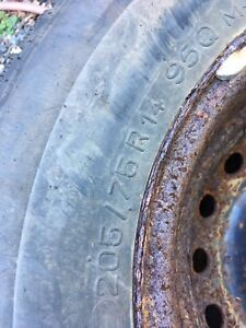 2 Winter tires on rims 205-75-14 almost new