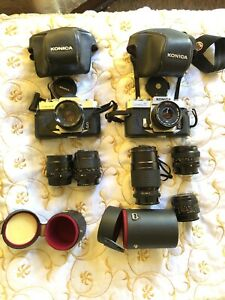 Two konica Autoreflex cameras hexanon 24mm and 6 more lenses