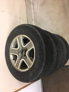 2003 Chevy Tracker rims and tires